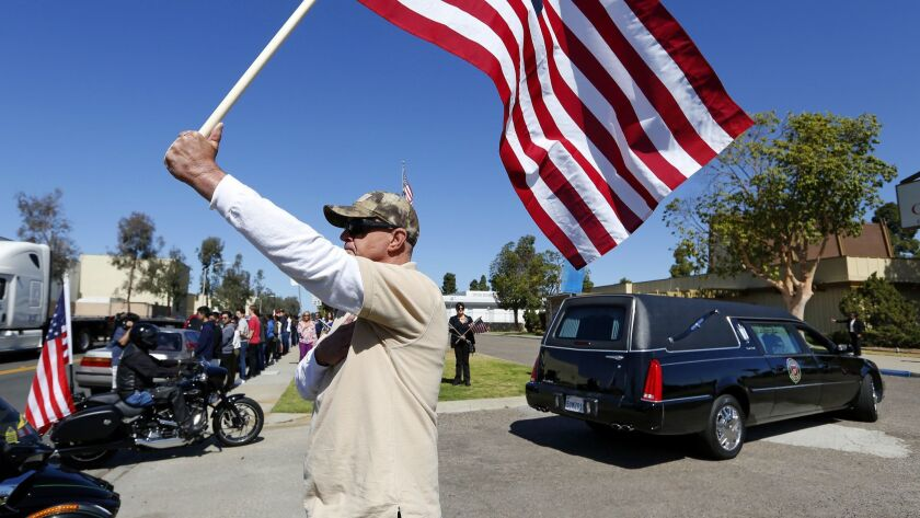 Residents lined the streets as the funeral procession for Gunnery Sgt. Derik Holley arrived at the Clairemont Mortuary.