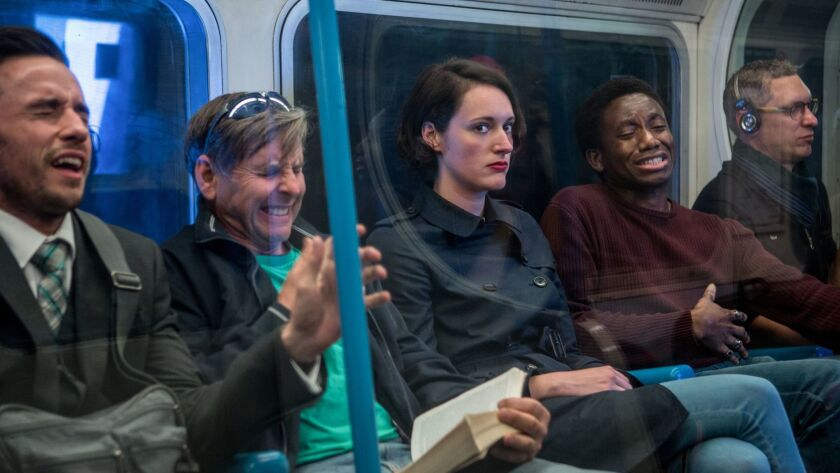 Phoebe Waller-Bridge, center, in a scene from the series 'Fleabag.' Credit: Amazon Studios