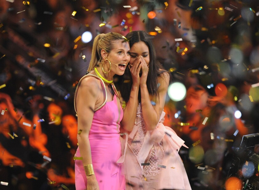 """Heidi Klum, left, stands with Lovelyn Enebechi during the finale of """"Germany's Next Top Model."""""""