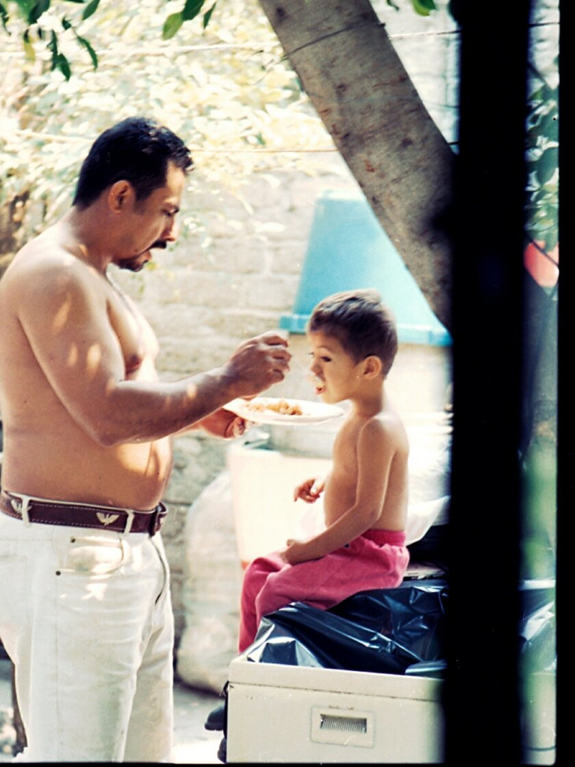 Edgar Jimenez Lugo gets reaquainted with his father, David Antonio Jimenez Solis, at their home in Tejalpa, Mexico. David had recently returned from the United States when this photo was taken.
