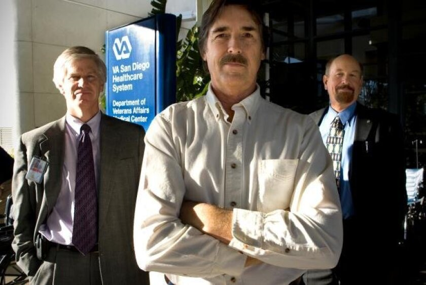 Patient Jeff Baker (center) is flanked by the VA Medical Center's Chief of Staff Dr. Robert Smith (left) and Kaiser's chief medical information officer Dr. John Mattison.