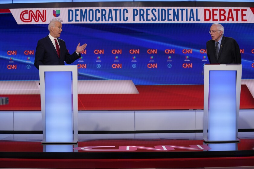 Former Vice President Joe Biden, left, and Sen. Bernie Sanders, I-Vt., right, participate in a Democratic presidential primary debate at CNN Studios in Washington, Sunday, March 15, 2020. (AP Photo/Evan Vucci)
