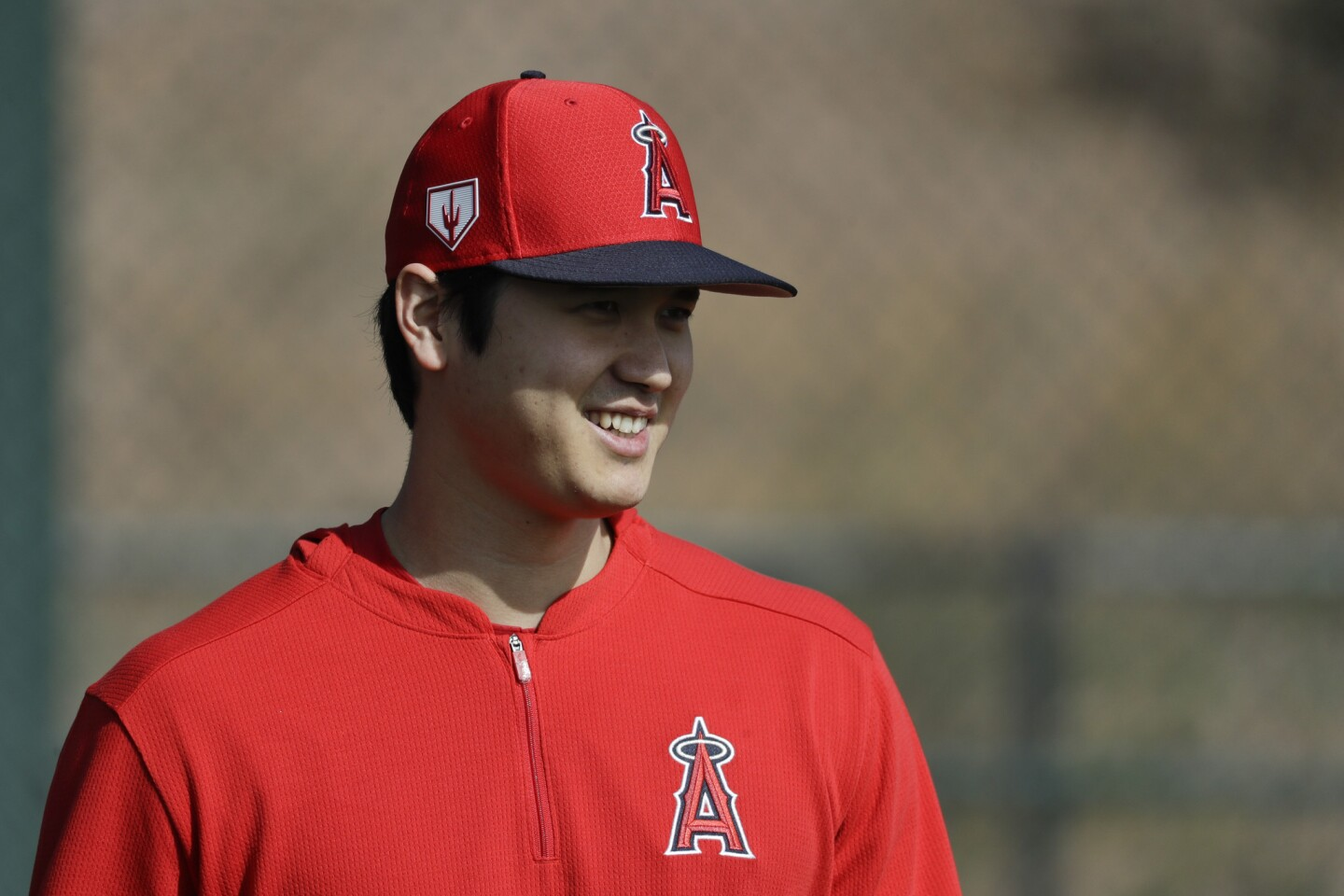 Los Angeles Angels' Shohei Ohtani, of Japan, walks on the practice field at their spring baseball training facility in Tempe, Ariz., Friday, Feb. 15, 2019. (AP Photo/Chris Carlson)