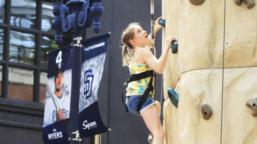 SAN DIEGO, CA March 31st 2018   Addison McCollum, 10, climbs a rock wall at the 8th Annual East Vill