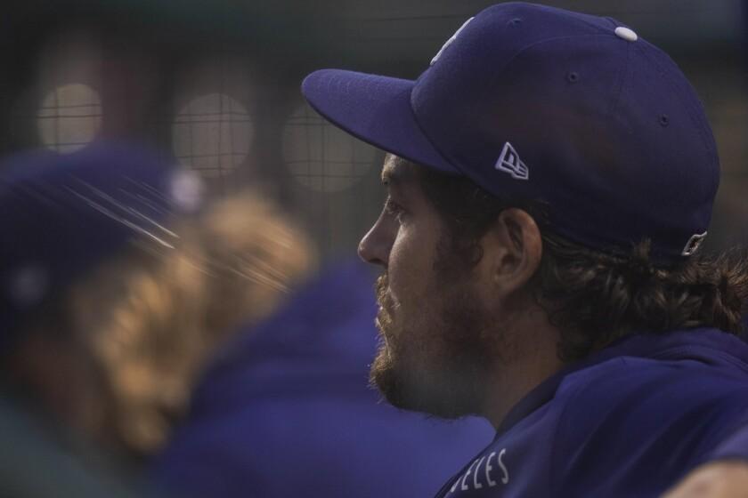 Dodgers pitcher Trevor Bauer observes a game.