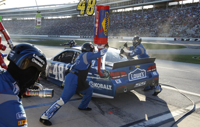 Jimmie Johnson (48) pits during the NASCAR Sprint Cup Series auto race at Texas Motor Speedway in Fort Worth, Texas, Sunday, Nov. 8, 2015. (AP Photo/Ralph Lauer)