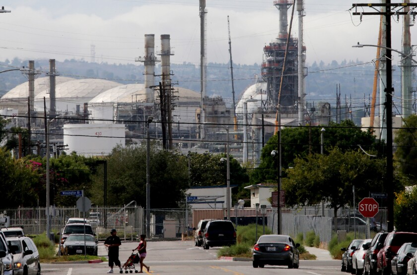 A refinery complex sits adjacent to a neighborhood in Wilmington.