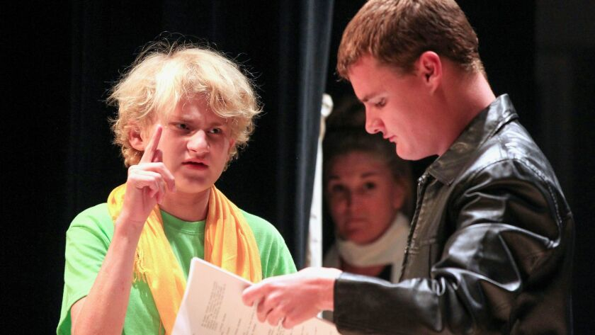 Students Liam Porter (left, as the Little Prince) and Reid Moriarty (as the Pilot) run through a sce