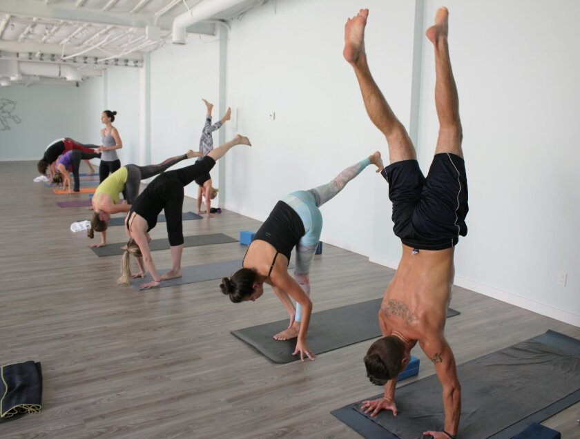 Buddhi Yoga at 7843 Girard Ave., Suite F (left) has more than doubled its studio space