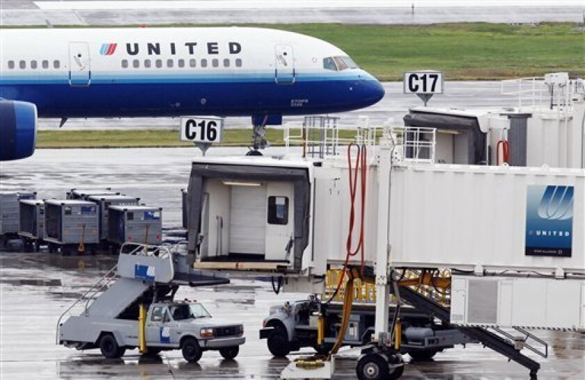 FILE - In this July 21, 2009, a United Airlines jet leaves the gate at Logan International Airport in Boston. United Airlines said Tuesday, Dec. 8, 2009, it placed an order for 25 of Boeing's long-awaited 787 widebody jetliners and 25 of the A350 aircraft from Airbus. (AP Photo/Michael Dwyer, file)