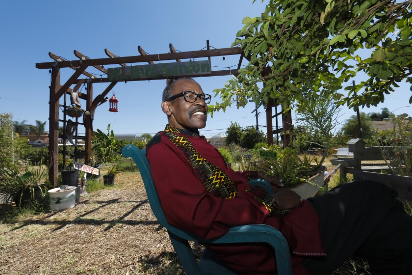 Community activist Robert Tambuzi takes a moment to relax at the Mount Hope Community Garden.