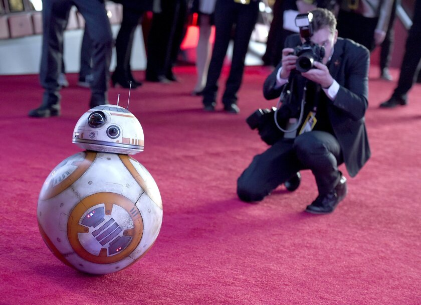 """Film character BB-8 arrives at the world premiere of """"Star Wars: The Force Awakens"""" at the TCL Chinese Theatre on Monday, Dec. 14, 2015, in Los Angeles. (Photo by Jordan Strauss/Invision/AP)"""