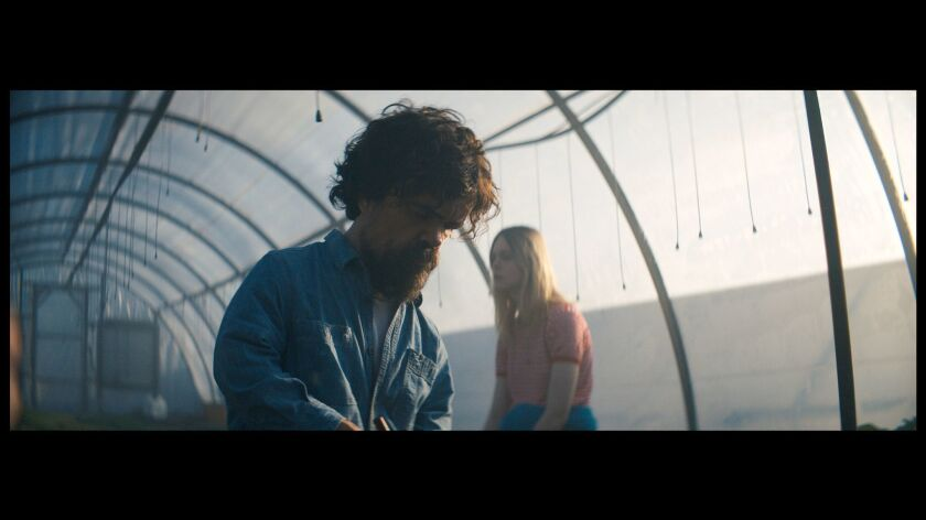 "Peter Dinklage and Elle Fanning in a scene from ""I Think We're Alone Now."""