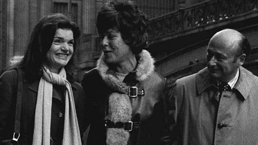 Jackie Onassis, left, and television personality Bess Myerson, center, and former New York City Mayor Ed Koch in 1975.