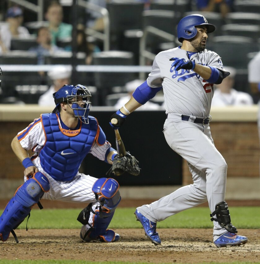Los Angeles Dodgers' Adrian Gonzalez looks after hitting a two run single during the ninth inning of the baseball game against the New York Mets at Citi Field, Sunday, May 29, 2016 in New York. (AP Photo/Seth Wenig)