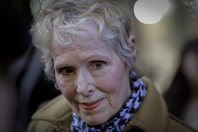 E. Jean Carroll talks to reporters outside a courthouse in New York.