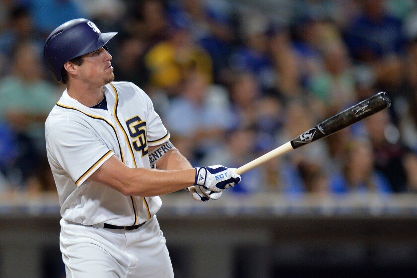 Padres right fielder Hunter Renfroe hits an eighth-inning grand slam against the Los Angeles Dodgers at Petco Park.