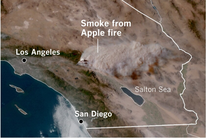 A satellite image shows the pyrocumulus plume from the Apple fire rising about 32,000 feet into the atmosphere