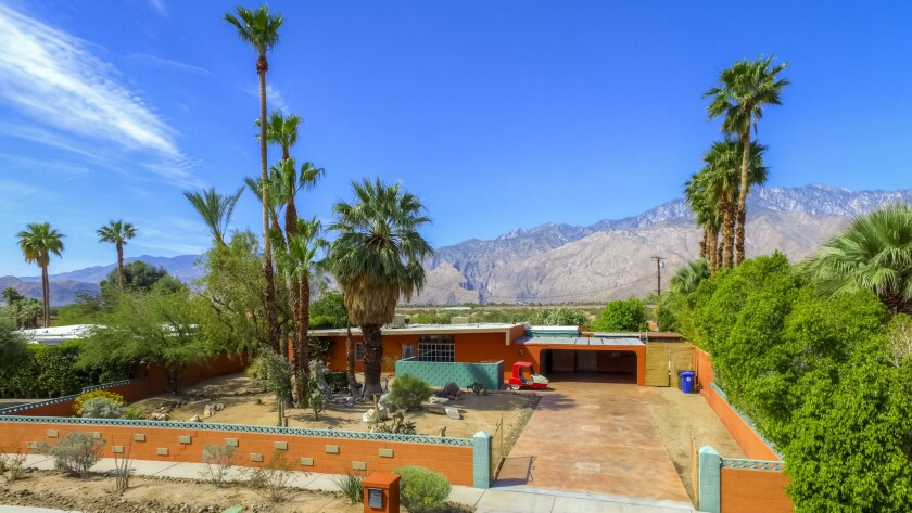 The flat-roofed home in Palm Springs maintains its Midcentury Modern vibe.