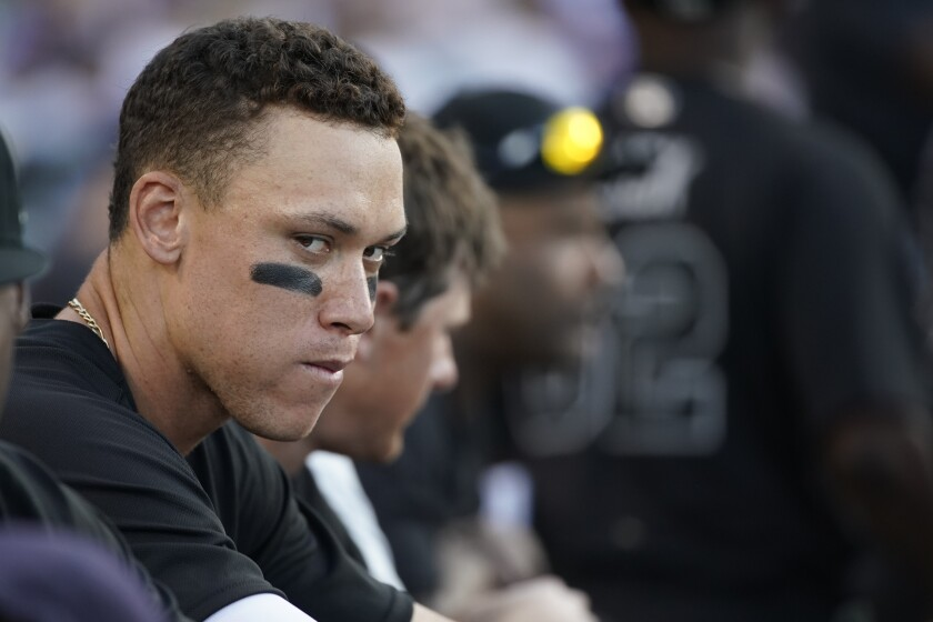 New York Yankees right fielder Aaron Judge stands in the dugout during Sunday's win over the Dodgers.