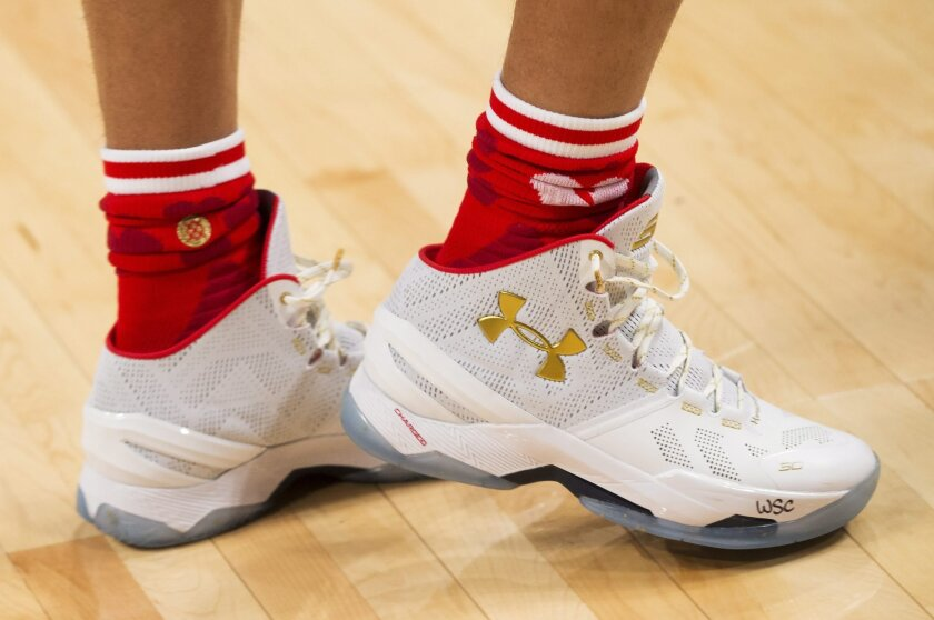 Golden State Warriors guard Stephen Curry (30) custom shoes are shown during the first half of the NBA all-star basketball game, Sunday, Feb. 14, 2016 in Toronto. (Mark Blinch/The Canadian Press via AP) MANDATORY CREDIT