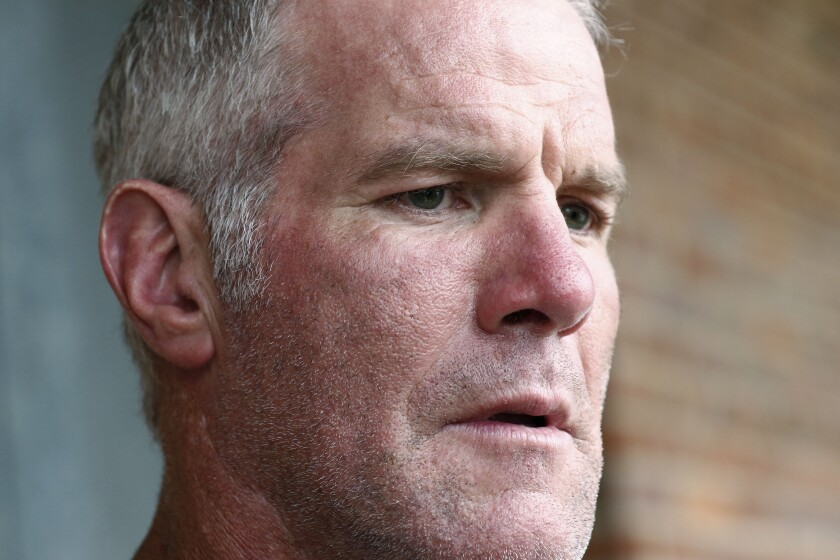 FILE - In this Oct. 17, 2018, file photo, former NFL quarterback Brett Favre speaks with reporters in Jackson, Miss., about his support for Willowood Developmental Center, a facility that provides training and assistance for special needs students. Favre has yet to pay back $600,000 in welfare money he received from the state of Mississippi for multiple speaking events he never showed up to, according to a spokesperson for Mississippi Office of the State Auditor Logan Reeves, Tuesday, May 11, 2021. (AP Photo/Rogelio V. Solis, File)