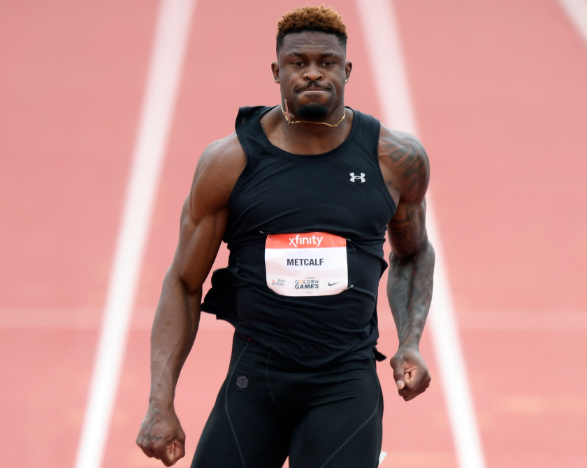 DK Metcalf crosses the finish line after competing in the men's 100-meter dash at the USATF Golden Games.