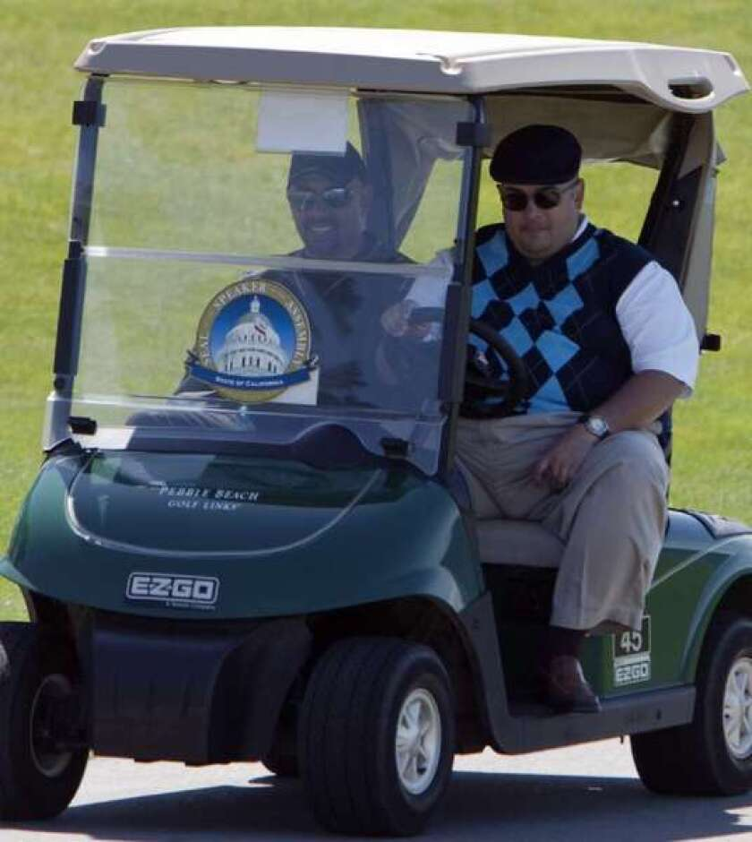 Assembly Speaker John Perez, right, drives a golf cart during a golf tournament fundraiser hosted by AT&T at Pebble Beach Golf Course in May 2011. At the 2013 event, Perez asked former Assemblyman Tom Calderon to leave, and returned a $20,000 check from Calderon's client to the Democratic Party.