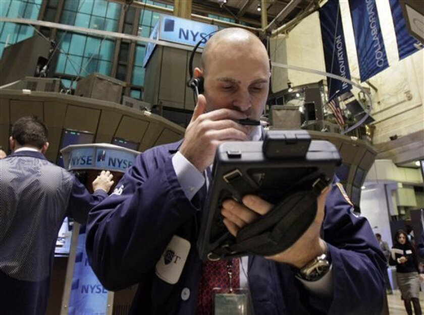 In this March 15, 2011 photo, trader Joseph Scheurmann works on the floor of the New York Stock Exchange Tuesday, March 15, 2011. (AP Photo)