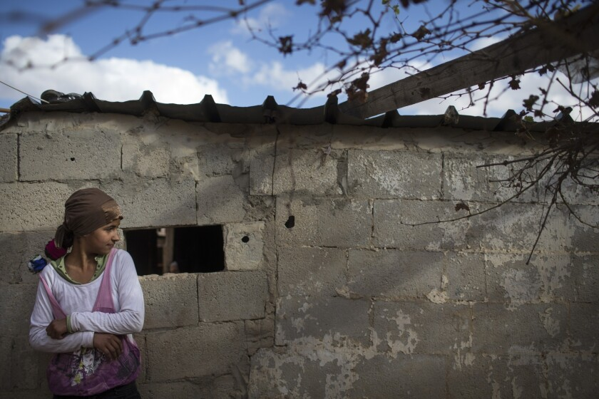 A Bedouin girl stands in her yard in Israel. Denying Bedouin Arabs full realization of the rights of citizenship has alienated them and pushed them away from membership in the Israeli polity.