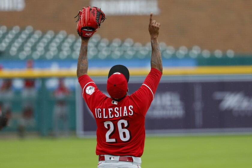 Cincinnati Reds relief pitcher Raisel Iglesias celebrates the final out against the Detroit Tigers in the seventh inning of the first baseball game of a doubleheader in Detroit, Sunday, Aug. 2, 2020. (AP Photo/Paul Sancya)
