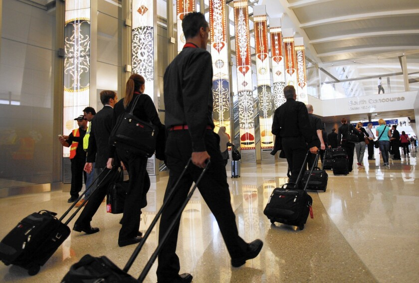 Flight attendants say a passenger's attitude often is what determines who gets kicked off a plane. Above, travelers at Los Angeles International Airport.