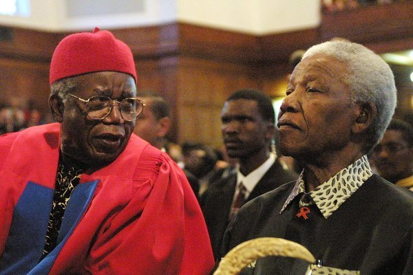 Chinua Achebe, left, Nelson Mandela in South Africa in 2002. Achebe was awarded an honorary degree of doctor of literature and delivered the third Steve Biko Memorial Lecture at the University of Cape Town.