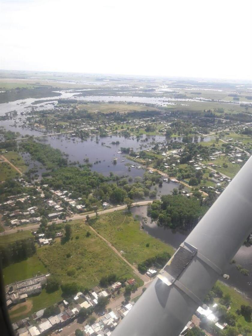 Courtesy image of the Uruguayan air force showing a flooded town on Friday, Jan. 11, 2019, on the banks of the Yi River, in the district of Durazno, Uruguay. The swelling of various rivers and streams in the interior of Uruguay due to recent heavy rains has displaced 514 people, authorities said Friday. EPA-EFE/Uruguayan Air Force/EDITORIAL USE ONLY/NO SALES