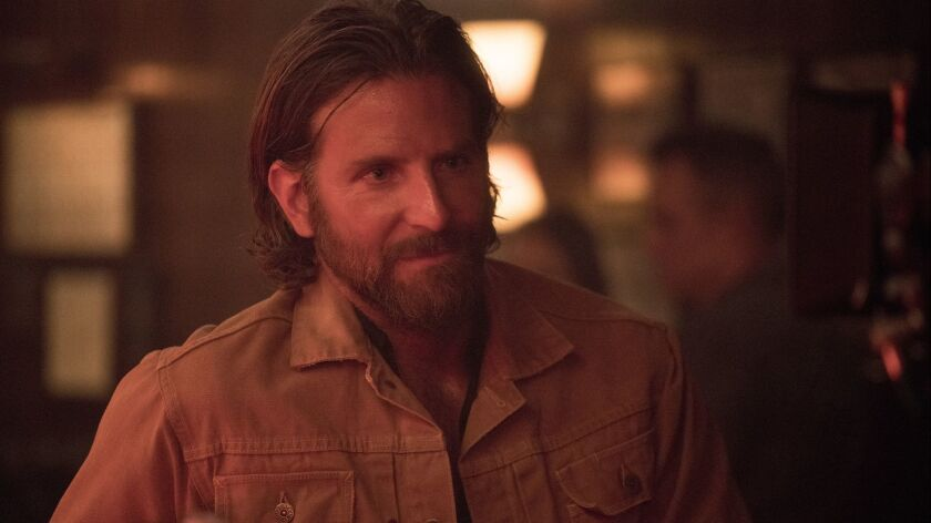 This image released by Warner Bros. shows Bradley Cooper in a scene from the latest reboot of the fi