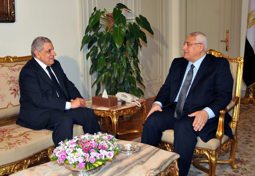 Egypt's interim President Adly Mansour, right, meets with Prime Minister Ibrahim Mahlab at the presidential palace in Cairo in February.