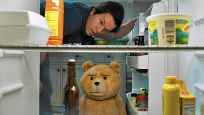 """John (Mark Wahlberg) and Ted (voiced by Seth MacFarlane) keep their friendship going through life changes in """"Ted 2."""""""