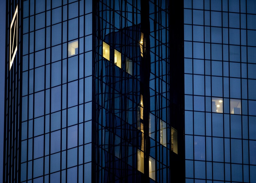 A few lights are on in the offices of the Deutsche Bank headquarters in Frankfurt, Germany, Wednesday, Jan. 27, 2021 as the partial lockdown in Germany goes on. (AP Photo/Michael Probst)
