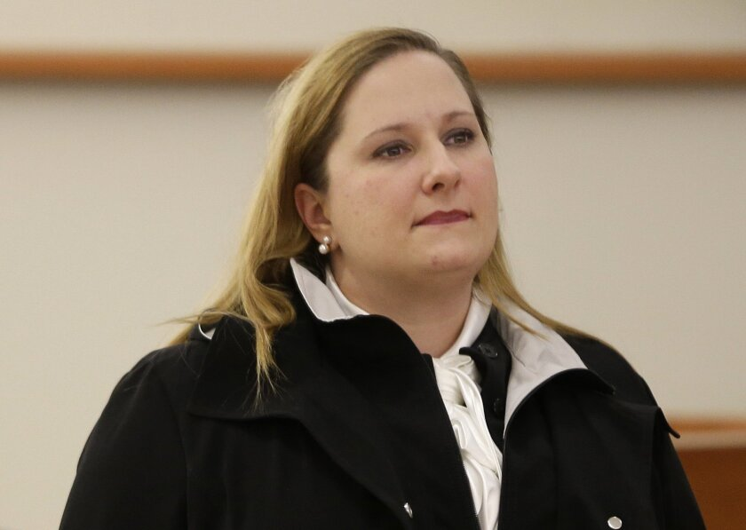 In this Feb. 8, 2016 photo, former New York City corrections officer Carol Lackner appears in court in New York. Lackner, who was arrested after a mentally ill inmate died in a stifling 101-degree cell on Rikers Island in 2014, has pleaded guilty to falsifying logbook entries saying she checked on