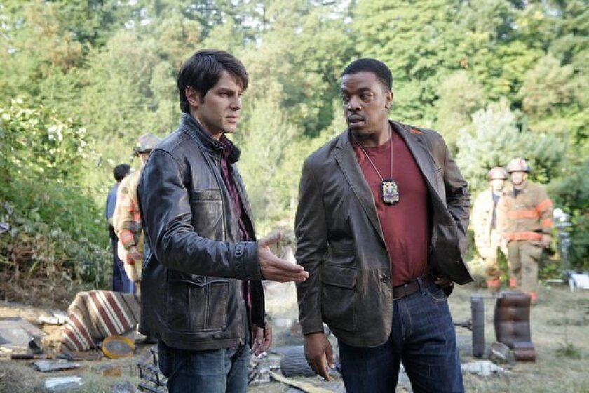 """David Giuntoli, left, plays as Nick Burkhardt and Russell Hornsby plays Hank Griffin in a scene from the TV series """"Grimm."""""""