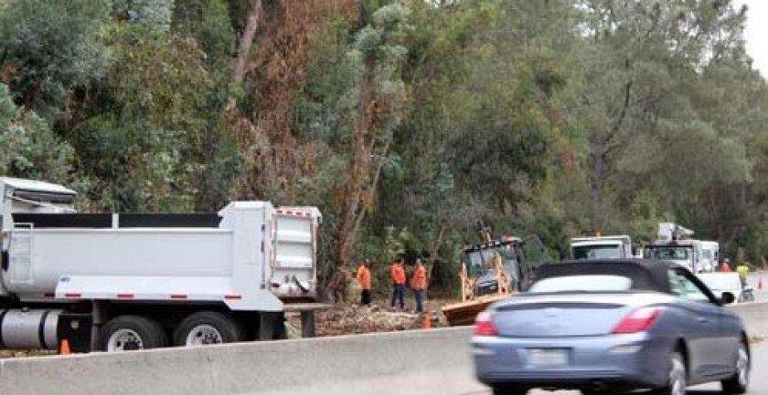 Crews work along Torrey Pines Road. Photo: Dave Schwab
