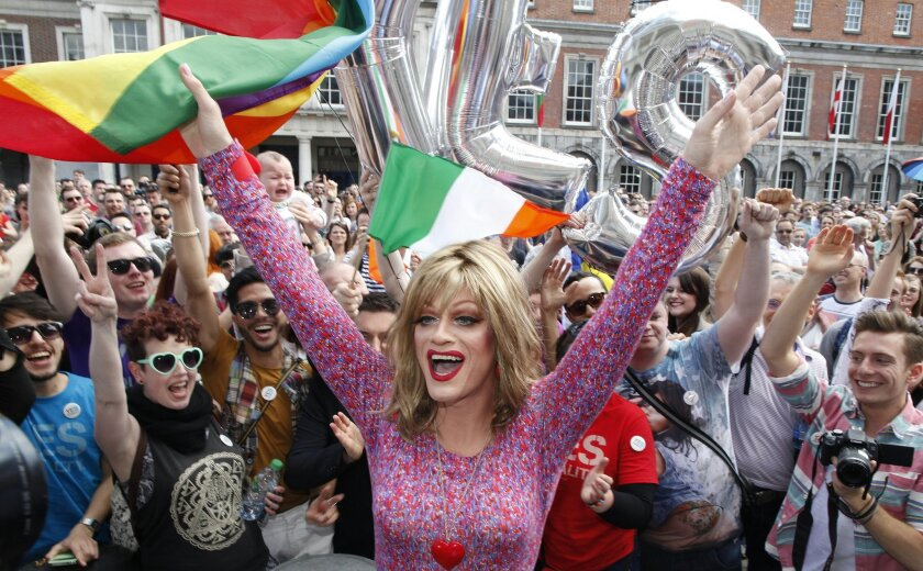 """Rory O'Neill, known by the Drag persona Panti, celebrates with yes supporters at Dublin Castle, Ireland, Saturday, May 23, 2015. Ireland has voted resoundingly to legalize gay marriage in the world's first national vote on the issue, leaders on both sides of the Irish referendum declared Saturday even as official ballot counting continued. Senior figures from the """"no"""" campaign, who sought to prevent Ireland's constitution from being amended to permit same-sex marriages, say the only question is how large the """"yes"""" side's margin of victory will be from Friday's vote. (AP Photo/Peter Morrison)"""