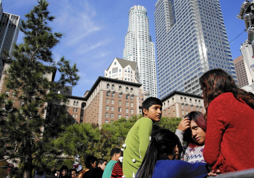 Students from Los Angeles Big Picture High School wait to ice skate in Pershing Square, just blocks away from their charter school, which is in a Wilshire Boulevard high-rise.
