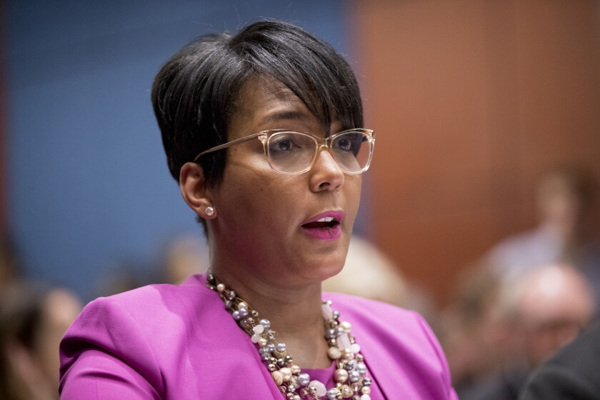 FILE - In this July 17, 2019, file photo, Atlanta Mayor Keisha Lance Bottoms speaks during a Senate Democrats' Special Committee on the Climate Crisis on Capitol Hill in Washington. When the United States erupted in unrest following Martin Luther King Jr.'s assassination in 1968, his hometown of Atlanta was one of the few major cities to maintain relative peace. Mayor Keisha Lance Bottoms invoked that history in a passionate and deeply personal plea for protesters to go home. (AP Photo/Andrew Harnik, File)