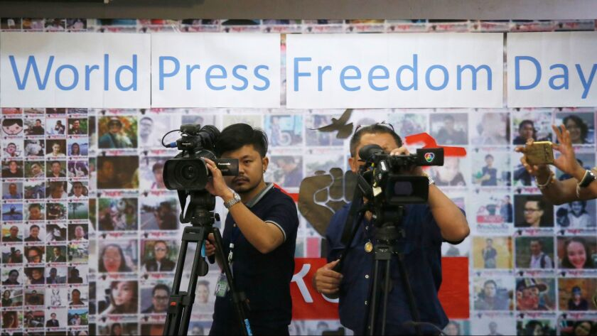 Thai video journalists working at Thai Journalists Association during the International World Press