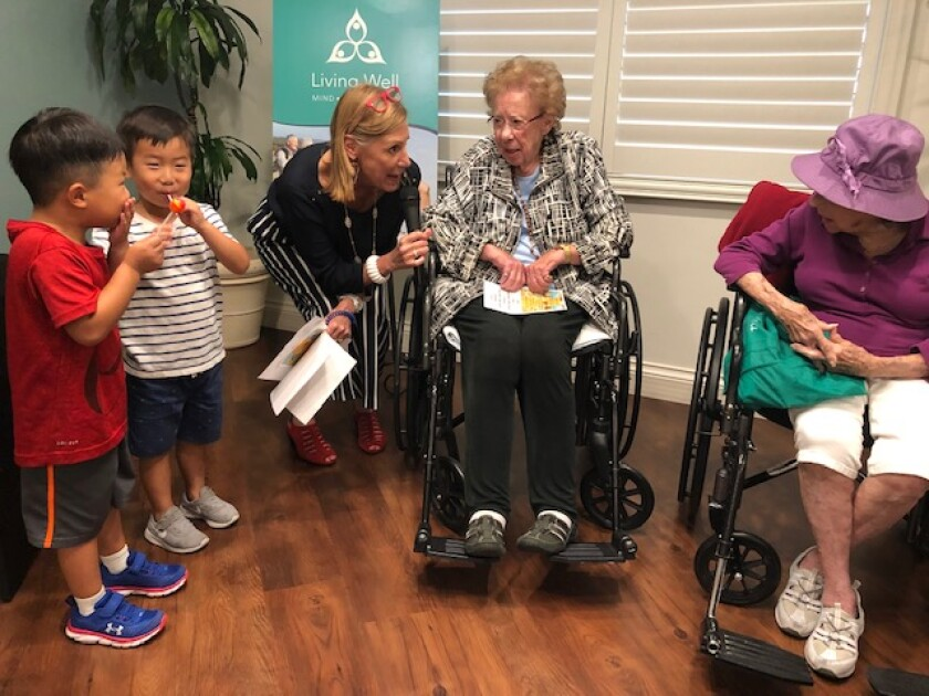 Two 4-year-old boys with Vi community relations manager Theresa Latosh, Captain Georgia McKearly and Evelyn Murray. gather Sept. 22, 2019 for a National Centenarian Day event held at the senior living community, Vi at La Jolla Village.