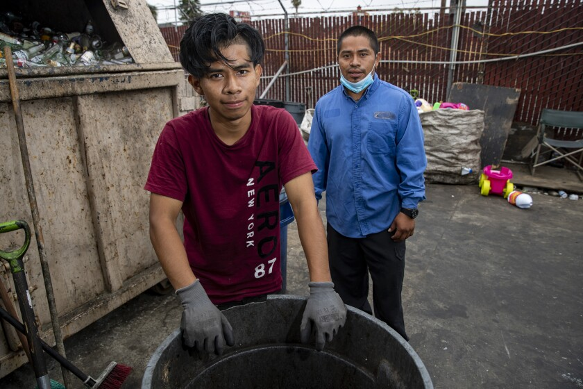 Gadseel Quiñonez and his brother Jose Quiñonez at the recycling center where they work.
