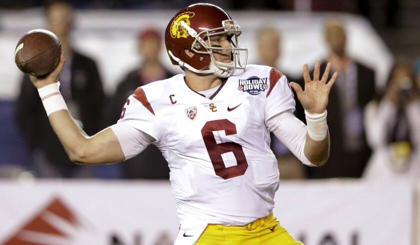 Cody Kessler throws a touchdown pass in his last game with USC