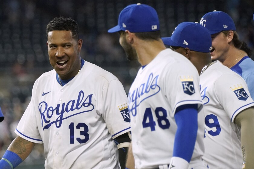 Kansas City Royals' Salvador Perez (13) talks with teammates after hitting a walk-off single in the ninth inning of a baseball game against the Cincinnati Reds Tuesday, July 6, 2021, in Kansas City, Mo. The Royals won 7-6. (AP Photo/Charlie Riedel)