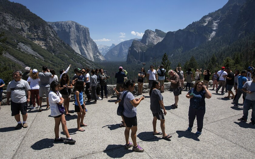 Yosemite National Park tourists visit Tunnel View on July 14, 2017. Trump administration proposals to make U.S. national parks more attractive to young people and improve the quality of National Park Service facilities have been met by fierce opposition by conservation groups and senior citizen advocates.